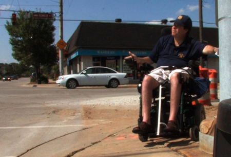 Nearly two decades after the Americans with Disabilities Act became law, a Times investigation found the region remains rife with barriers that make it difficult for disabled residents to board trains, visit libraries, eat at restaurants and take part in other simple pursuits. The three-month investigation found front doors, ramps, parking spaces and bathroom facilities that limit or completely bar access to disabled residents such as Rich Garza, above, who is seen navigating Kennedy Avenue in Highland. (Photograph by John J. Watkins/The Times.)