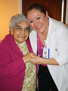 Lucy Guzman, 81, shows her appreciation to Virginia Madrinia, R.N. and coordinator of the Chest Pain Center at St. Catherine's in East Chicago. In April, Guzman suffered the most critical type of heart attack. (Photograph by The Times.)