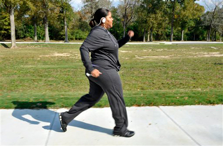 Deidra Atkins-Ball, 44, walks in Forest Park Tuesday, Nov. 23, 2010, in Baton Rouge, La. Atkins-Ball has diabetes and took part in a study where she was in a nine-month fitness program combining aerobics and weight training. She successfully lowered her blood sugar levels. People with diabetes should mix aerobics with weight training to get the best results in lowering blood sugar, a new study suggests. The combination worked best for weight loss too, compared to aerobics or weight training alone. Blood sugar is fuel to muscles, and more sugar is burned during aerobic activity. Weight training builds more muscle, and both activities change muscle proteins in ways that enhance the process. (AP Photo/Bill Feig)