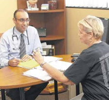 Omar Shamsi, M.D., helps patients in the Healthy 4 Life program at Methodist Hospitals' ReStart Center at the Southlake Campus. (Photograph provided by Methodist Hospitals.)