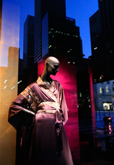 A Saks Fifth Ave., store window is shown Tuesday, Aug. 18, 2009, in New York. Retailer Saks Inc. said Tuesday its second-quarter loss widened as consumer spending on luxury fashion continued to languish, but the loss was not as big as analysts expected. (Photograph by Mark Lennihan/AP.)