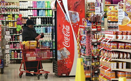 In this Jan. 28, 2010 photo, a customer shops the grocery section at the Family Dollar discount store in Brooklyn, New York. Retail sales posted a better-than-expected increase in January, a welcome development that could mean stronger economic growth in coming months. (AP Photos/Bebeto Matthews)