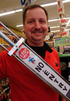 Gus Bock Ace Hardware store manager Tom Grill holds the No Entry NE 1000, a home security device designed by two customers of the Munster store, Sam Keith and Burt King. (Photograph by Tony V. Martin/The Times.)