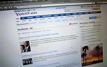A screen shot of Associated Press news content on the Yahoo news website is shown in San Francisco, Monday, Feb. 1, 2010. The Associated Press has signed a licensing deal with Yahoo Inc. that gives the news cooperative a steady stream of revenue at a time less money is flowing in from newspapers and broadcasters. (AP Photo/Jeff Chiu)