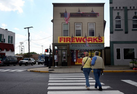 Pedestrians cross Main Street in Crown Point on Friday. Fiesta Mexico, a restaurant on the Crown Point square, was damaged by fire a few months ago and has reopened as a fireworks shop. Once a retailer has a state permit, there's a little a municipality can do to control where a fireworks store can locate. (Photograph by The Times.)