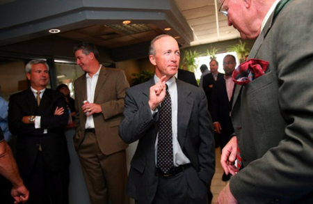 Indiana Gov. Mitch Daniels talks with guests Wednesday at the signing of a memorandum of understanding committing both states to plan and develop the expressway during a ceremony Wednesday at the Lansing Municipal Airport. (Photograph by Natalie Battaglia/The Times.)
