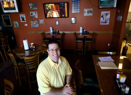 Co-owner Dan Zunica sits inside Danny Z's Pub & Grub, a Munster restaurant located in the former Beef O'Brady's restaurant site a block east of Dante's House of Pizza, which he and his wife also own. (Photograph by The Times.)