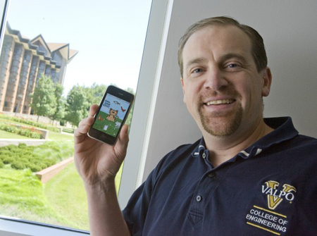 Valparaiso University electrical and computer engineering professor Jeff Will has developed his own iPhone application called Here Kitty, Kitty! Will said it took him two weeks to develop the application, which plays various recordings to attract a cat. (Photograph by The Times.)