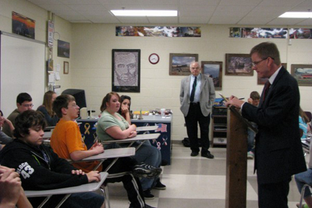 "Attorney Kevin Marshall questions ""prospective jurors"" in an eighth-grade classroom at Hanover School in Cedar Lake during his Law Day visit. Marshall and paralegal Jack Walter, background, conducted a mock jury selection to show the students how a jury is selected for trial. (Photograph by The Times.)"