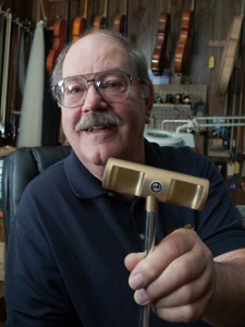 Richard Biggs has invented a unique golf club called the Palm Putter and will showcase the United States Golf Association-approved putter this weekend on golf courses in Chesterton and Munster. (Photograph by The Times.)