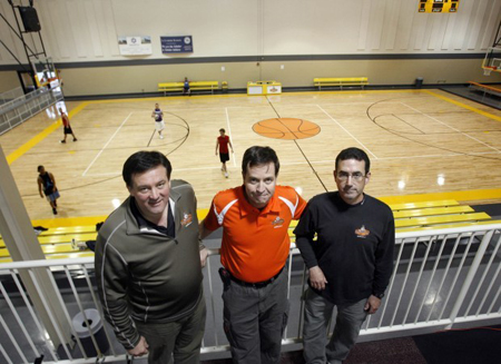 General manager John Stroia, left, owner Mark Leyden and Mike McNamara, operations manager, run the Fieldhouse-Merrillville, which offers basketball leagues, tournaments, and camps. Open since November 2008, the 53,000-square-foot facility has six NCAA regulation-size basketball courts. (Photograph by The Times.)