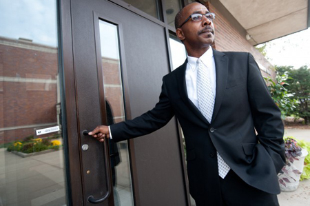 Newly-appointed East Chicago mayor Anthony Copeland opens the door to the administration building on Monday as he makes his way to his office for a meeting. (Photograph by The Times.)