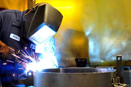 A worker welds parts together at the Tri-State Industries manufacturing plant in Hammond. Some manufacturers cannot fill their openings. The problem, companies say, is a mismatch between the kind of skilled workers needed and the ranks of the unemployed. (Photograph by The Times.)