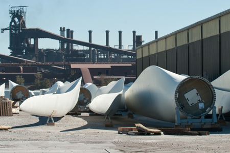 Wind turbine fan blades sit in the Port of Indiana Burns Harbor before being shipped out. (Photograph by The Times.)