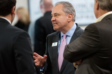 Gus Olympidis, president and CEO of Family Express, speaks with visitors on Thursday during an open house for its new Valparaiso headquarters. The new building boasts a fitness center for Family Express employees and a full-scale replica of a Family Express facility for training. (Photograph by The Times.)
