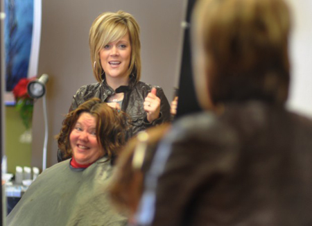 Arden Salon hairdresser Emily Odinsoff, of Valparaiso, styles Kouts' Sharon Hoover's hair Sunday at Absolute Style in Valparaiso. (Photograph by Michael McArdle/The Times.)