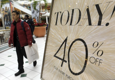 Shoppers take advantage of sales while shopping during Black Friday at the Pentagon City Mall in Arlington, Va. Retail sales rose for a fifth straight month in November as the biggest jump in department store sales in two years got the holiday shopping season off to a jolly start. (AP Photo/Susan Walsh)