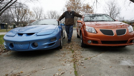 Richard Orelup, of Valparaiso, will miss Pontiac. Orelup owns a 1999 metallic blue Firebird Trans Am and an orange 2005 Vibe. GM's agreements with Pontiac dealers ended Oct. 31. It decided to kill the brand last year. (Photograph by John Luke/The Times.)