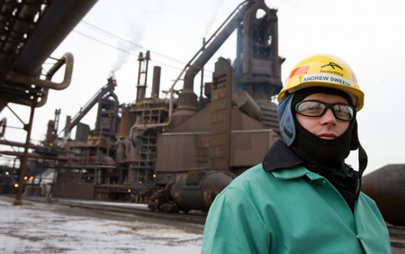 Jon Andrew Sweeney, of Matteson, stands in front of a blast furnace Thursday at the ArcelorMittal steel mill in Burns Harbor. Sweeney was just hired by ArcelorMittal after taking classes at Prairie State College in the Steelworker for the Future program. ArcelorMittal has hired four recent graduates of Steelworker for the Future, a training partnership launched two years ago to bring more craft workers into the steel industry, said Mark Langbehn, manager of hourly employee training at ArcelorMittal USA. (Photograph by Jon L. Hendricks/The Times.)