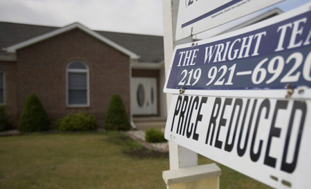 A home for sale in Portage had its price reduced. Sales of existing single-family homes fell just 4.3 percent in December as compared to December 2009 in the five counties covered by the Greater Northwest Indiana Association of Realtors. In some markets, sales were up, such as in Porter county, where 20.5 percent more homes were sold in December. (Photograph by Jon L. Hendricks, file/The Times.)
