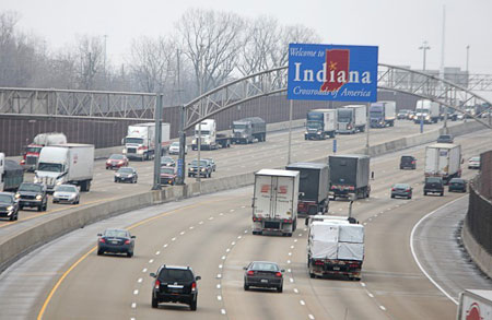 The Indiana welcome sign is shown above Interstate 80/94 looking eastbound from Wentworth Avenue in Lansing. A number of regional groups are cooperating on an advertising campaign to highlight the area's transportation infrastructure, proximity to Chicago, work force and facilities. (Photograph by Jonathan Miano/The Times.)