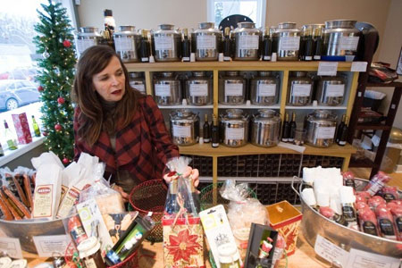 Nada Karas, co-owner of Good To Go by Lucrezia, shows some of the food baskets the store offers. The Chesterton business serves unique, gourmet, and healthy foods. Good To Go also serves olive oil and vinegar bottles that are refillable in the store. (Photograph by Jon L. Hendricks/The Times.)