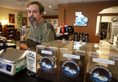 Mellow Brew Cheesecake owner Timothy Hendrickson doesn't allow smoking in his Dyer business, but he doesn't think the state should dictate the decision. He thinks it should be up to the business owners. (Photograph by John J. Watkins/The Times.)