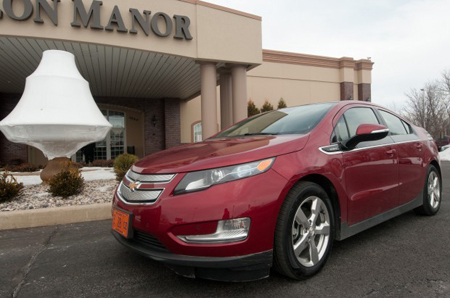 A 2011 Chevrolet Volt sits in front of Avalon Manor in Hobart on Tuesday as part of the South Shore Clean Cities annual meeting. A Think City car also was on display as part of the preview of electric vehicles. Automaker representatives touted the economic and environmental benefits of the vehicles. (Photograph by Kyle Telechan/The Times.)