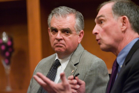 Ray LaHood, U.S. Secretary of Transportation, listens to U.S. Rep., Pete Visclosky, D-Ind., talk to media Thursday after the Rail Delivers Jobs summit at Sand Creek Country Club in Chesterton. (Photograph by Jon L. Hendricks/The Times.)