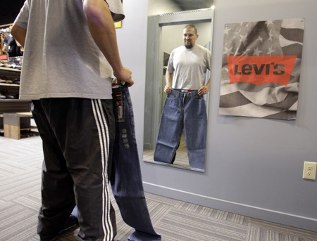 Customer Brian Begay looks at a pair of Levi Strauss &#038; Co. jeans at a store in Hayward, Calif. Cotton has more than doubled in price over the past year, and the price of other synthetic fabrics has jumped almost just as much as demand for alternatives and blends has risen. Clothing prices are expected to rise by 10 percent in the coming months. (Photograph by Paul Sakuma/The Associated Press.)