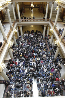 Hundreds of steelworkers, who packed the Statehouse in Indianapolis on Tuesday to ask legislators to vote down several so-called right-to-work proposals, gather for a group picture. (Photograph by AJ Mast/The Times.)