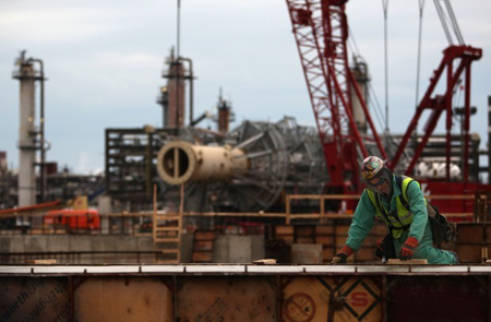 A worker builds around the current refinery at BP Whiting Refinery in Whiting, IN, Monday, November 29, 2010. The work is part of BP's $3.8 billion Whiting Refinery Modernization Project. The modernization project will increase the refinery's ability to refine heavier crude oil, including the oil from the Canadian tar sands. This oil contains more impurities than most of the 'light crude' oil being refined today. The project is slated to be completed in 2012. (Photograph by Heather Eidson/The Times.)