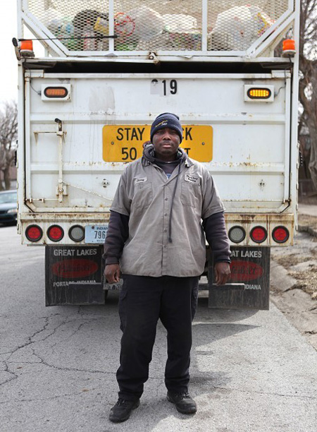 Gary city worker Antoine Brown, 38, Brown poses for a portrait on his recycling route. The Teamsters Local 142 member says he and other union members are fighting for survival. Attempts to weaken labor unions have roiled Democrats in Indianapolis and Madison, Wis., leading them to flee to Illinois rather than vote on the measures. (Photograph by Jonathan Miano/The Times)