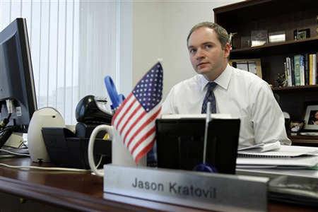 Jason Kratovil, lobbyist for the Independent Community Bankers of America, sits at his office in Washington. Bankers and merchants, pillars of the business world and frequent allies, are embroiled in a bitter lobbying war over something Americans do 38 billion times a year, swipe their debit cards. (AP Photo/Jose Luis Magana)