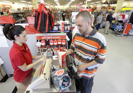 Family Dollar employee Pamela Ramos, left, assists John Conner, right, with a purchase at a store in Waco, Texas. In September 2010, Family Dollar had announced plans to spend $750 million to buy back its stock, which would be partially funded by its cash on hand. Then in October, the retailer said it had repurchased $250 million of its shares as part of its previous announcement. (AP Photo/Tony Gutierrezfile)